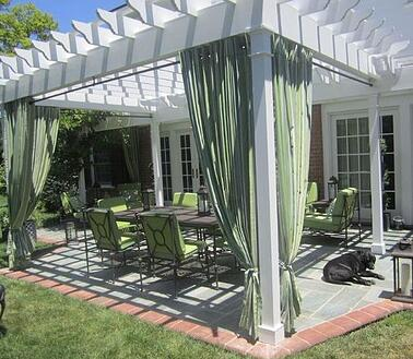 Curtains-draped-around-a-pergola.jpg